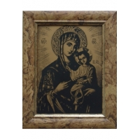 The icon of the Mother of God (in the frame)
